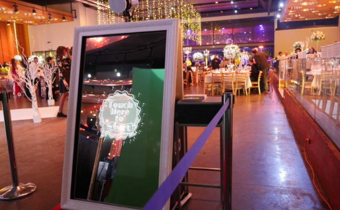 Mirror booth being used at a wedding